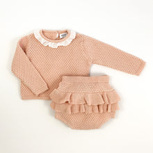 Load image into Gallery viewer, baby and toddler cute knitted set in soft shell pink. Adorable bloomers and knitted top for girls. Top has a pretty contrast frill to the neck in white and button fastenings down the back. Long sleeves. Stunning baby girl outfit.