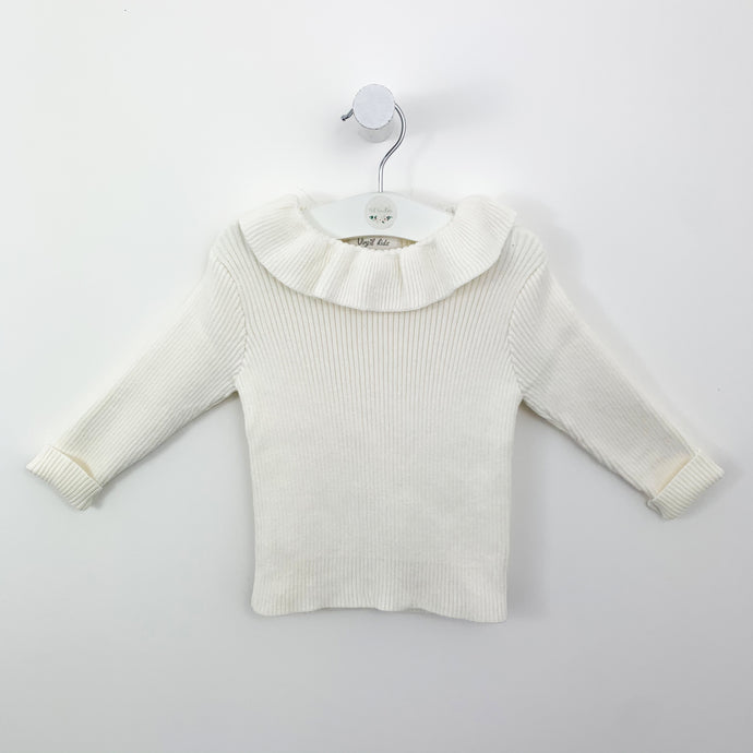 Frill collar knitted sweater for girls 12 months up to 3 years. Long sleeves in a rib knit fabrications. Shop our baby and toddler clothing collections at Bel Bambini.