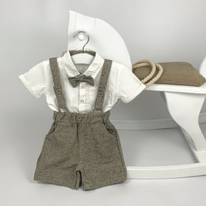 Baby boys and toddlers romper suit, grey dungaree shorts with a shirt and  grey bow tie. Formal set for special occasions.