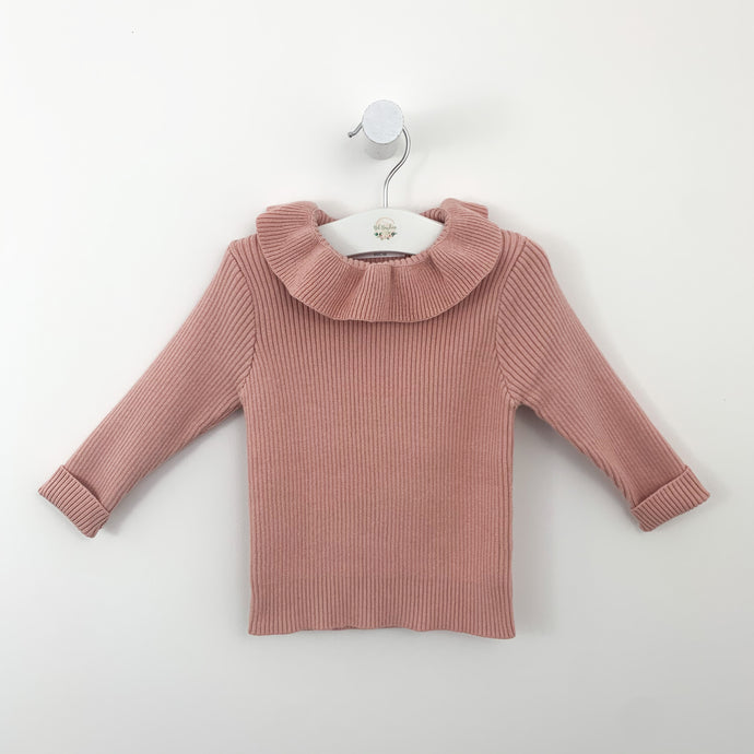Pink sweater with a frill collar and long sleeves for toddlers. Perfect for the cold winter days. Rib knitted fabrication which is warm and comfortable, available at Bel Bambini baby boutique.