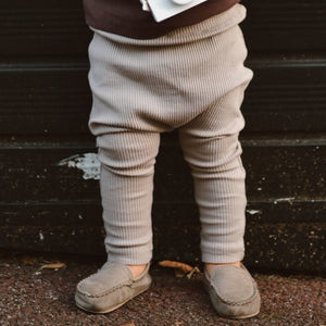 Rib knitted leggings for babies and toddlers. Beautiful shade of taupe. Comfortable leggings for 0-2 years. Shop our new Baby and toddler clothing collections at Bel Bambini baby clothing boutique.