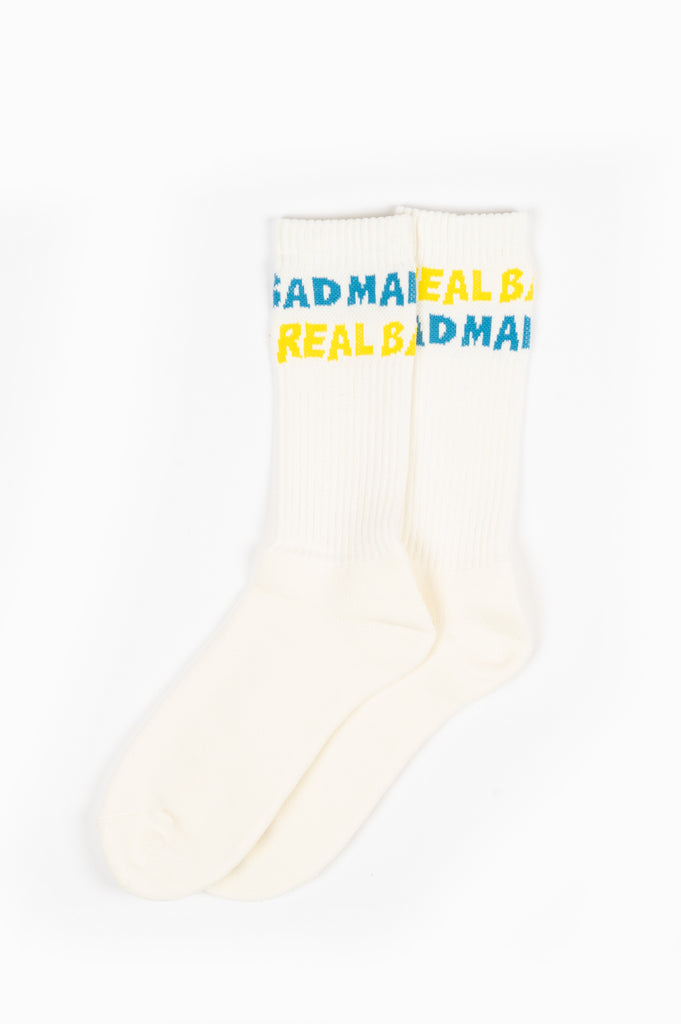 REAL BAD MAN SPELLOUT SOCKS YELLOW BLUE