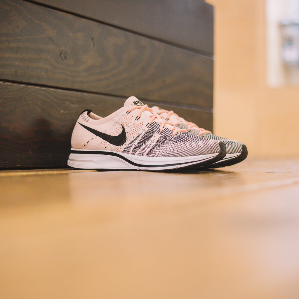 63457cb641ab NIKE FLYKNIT TRAINER SUNSET TINT BLACK WHITE – BEATNIC
