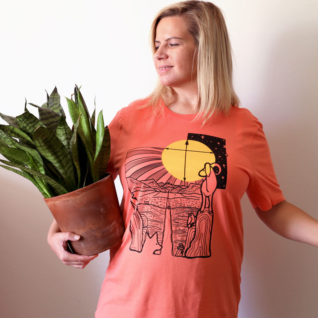 Woman wearing Safe Travels Desert Shirt in Coral