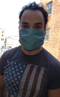 Handsome man wearing protective face mask