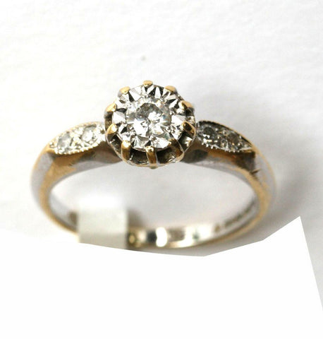 18ct white sol. With diamond shoulders(.25pts)