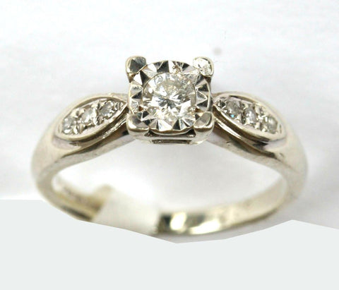 9ct white sol. With diamond shoulders(0.20pts)