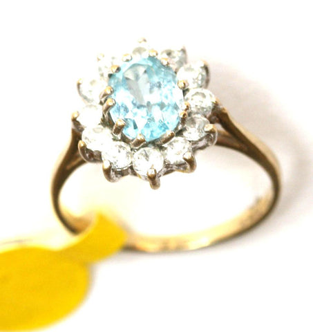 9ct yellow cubic zirconia & light blue stone