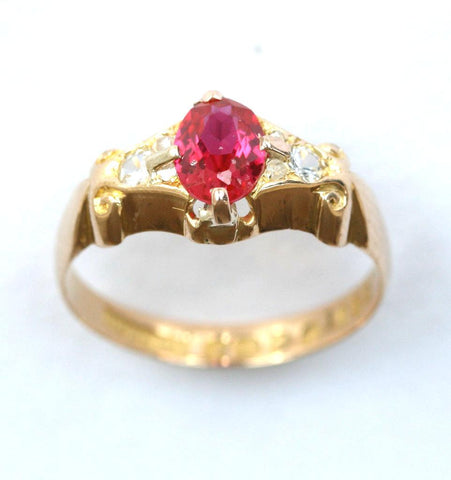 18ct ruby solitaire with diamond shoulders