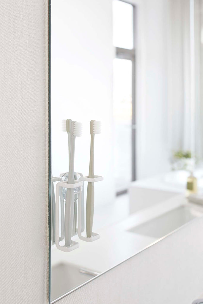 Tower Suction Cup Mounted Toothbrush Holder by Yamazaki
