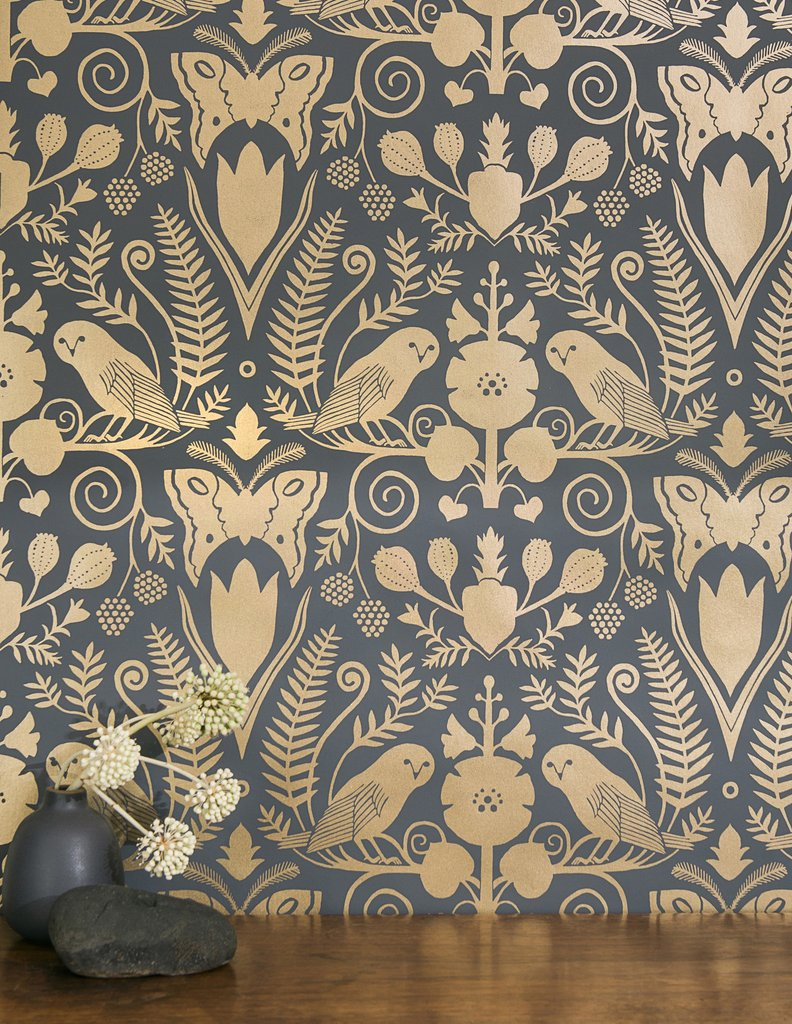 Barn Owls and Hollyhocks Wallpaper in Gold on Charcoal by Carson Ellis for Juju