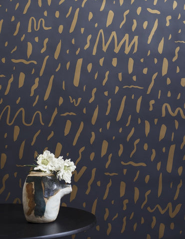 Bomba Wallpaper in Gold on Charcoal design by Juju