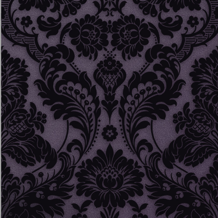 Gothic Damask Plum contrasts an opulent flock design with an equally luscious color palette. A raised pattern is created by sprinkling powdered wool and a shimmer plum backdrop is added that lends itself to promote a classic and sleek look. This wallpaper is beautifully metallic and rich in pattern resulting in a sophisticated look.