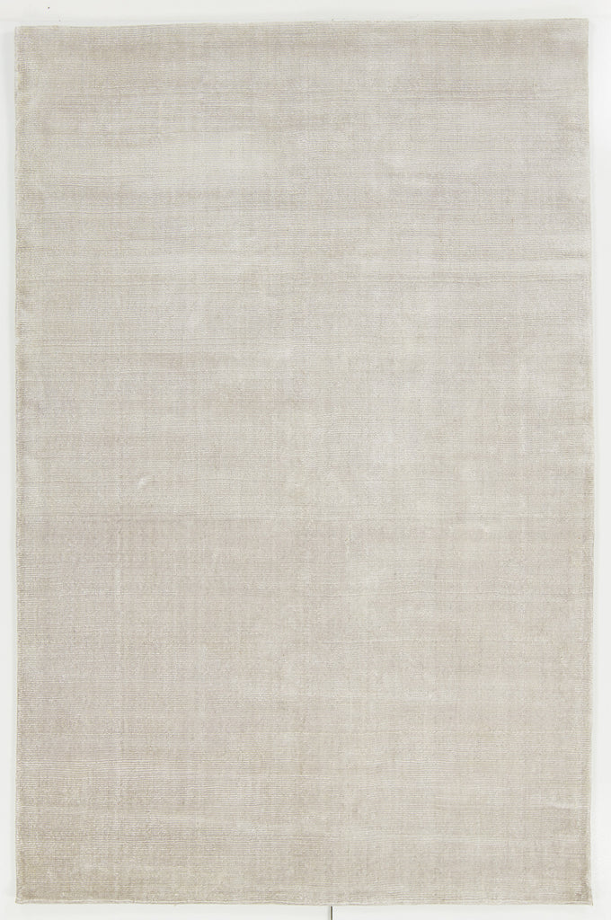 Libra Collection Hand-Woven Area Rug in Ivory