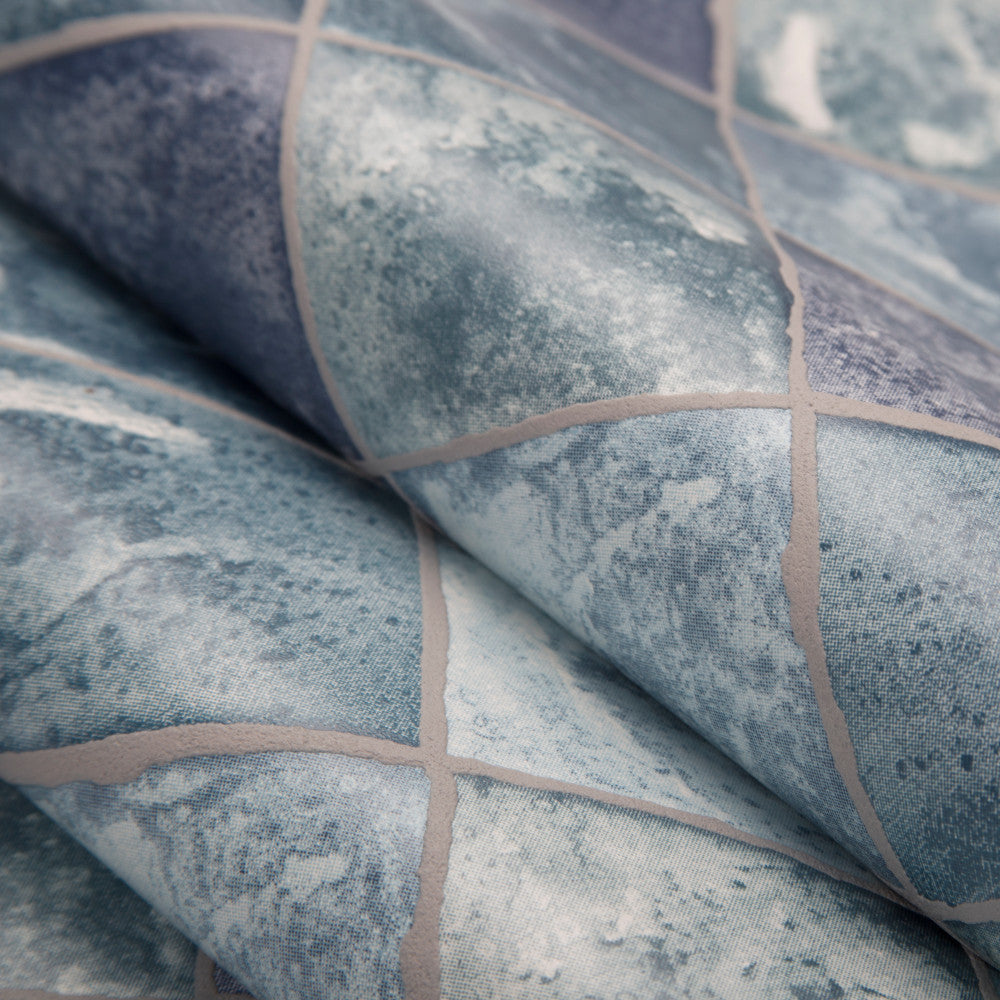 Lagoon Wallpaper in Blue from the Strata Collection by Graham & Brown