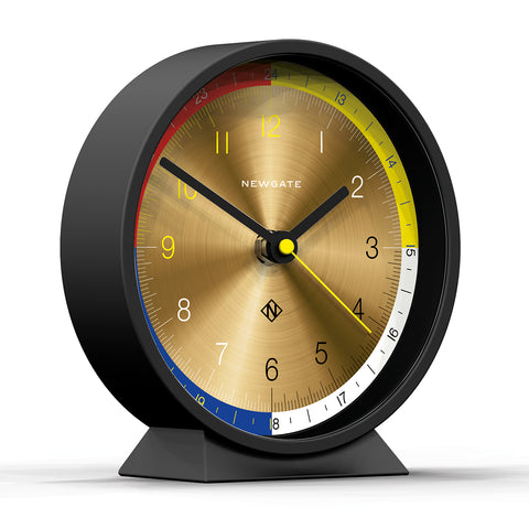 Mantel in Cave Black and Spun Brass Dial design by Newgate