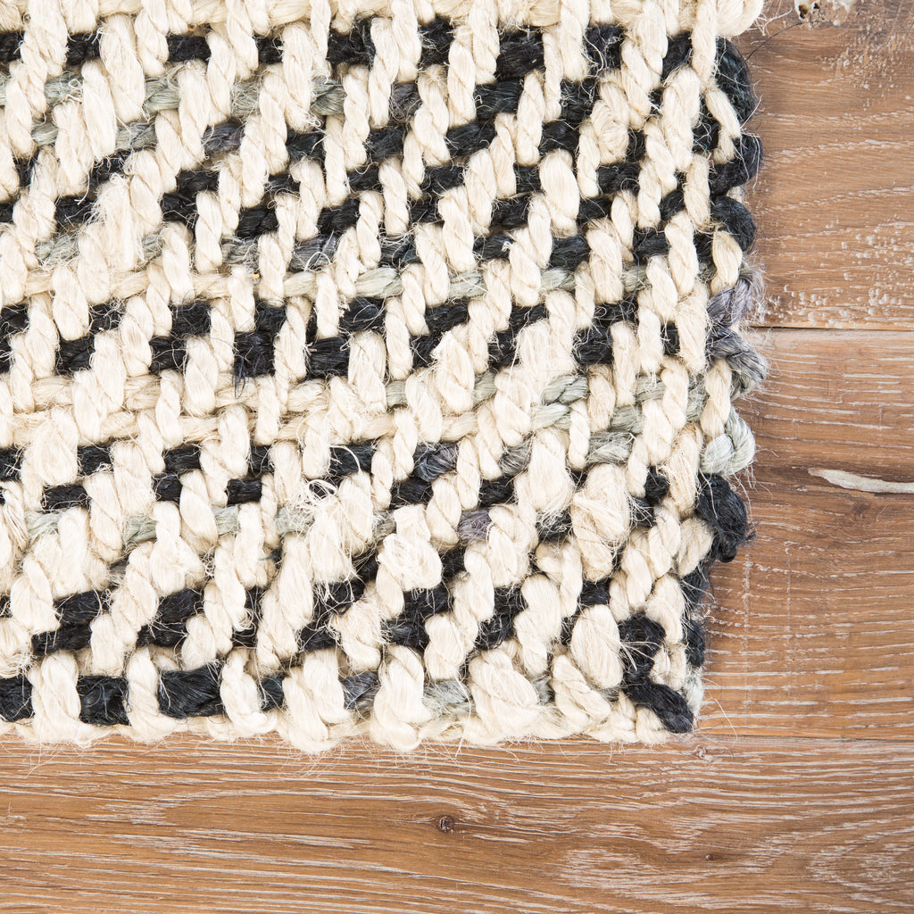Almand Natural Solid White & Black Area Rug