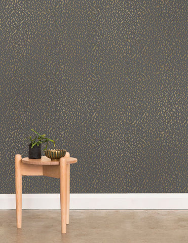 Palea Wallpaper in Gold on Charcoal design by Juju