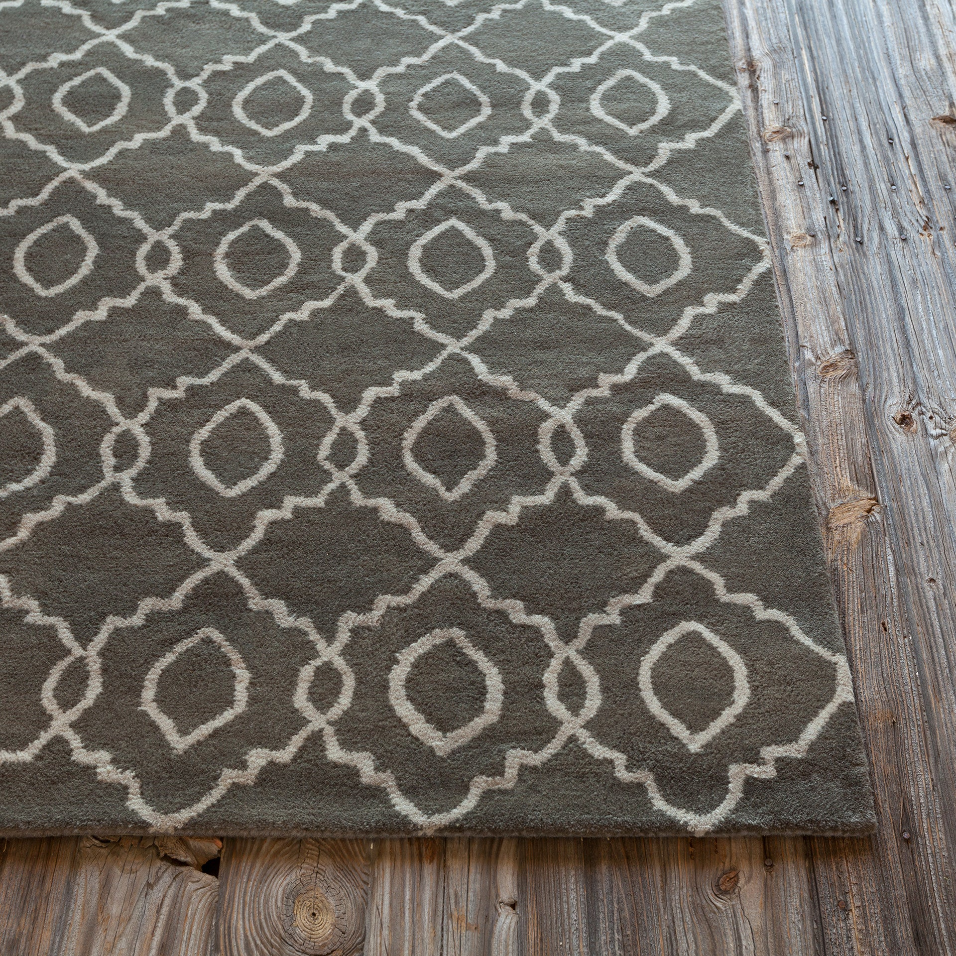Stella collection hand tufted area rug in charcoal cream