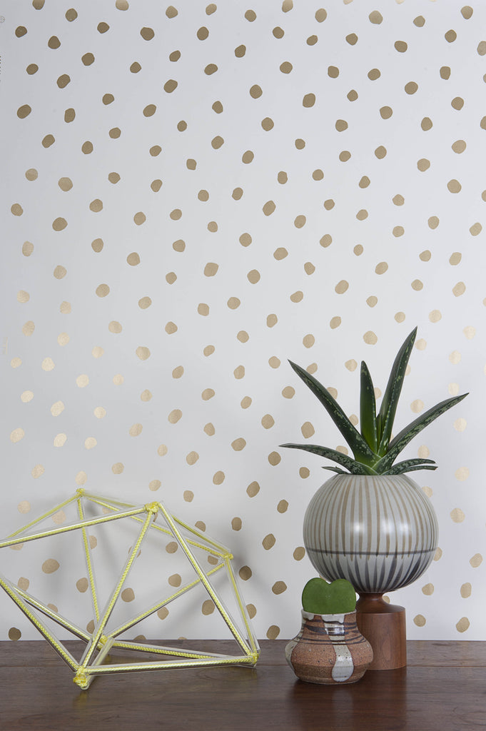 Sisters of the Sun Wallpaper in Gold and Cream design by Juju