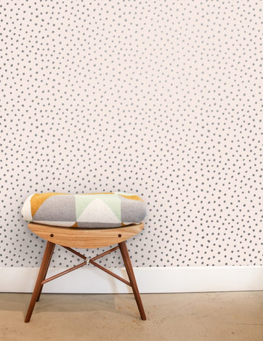 Sisters of the Sun Wallpaper in Gunmetal on Blush design by Juju