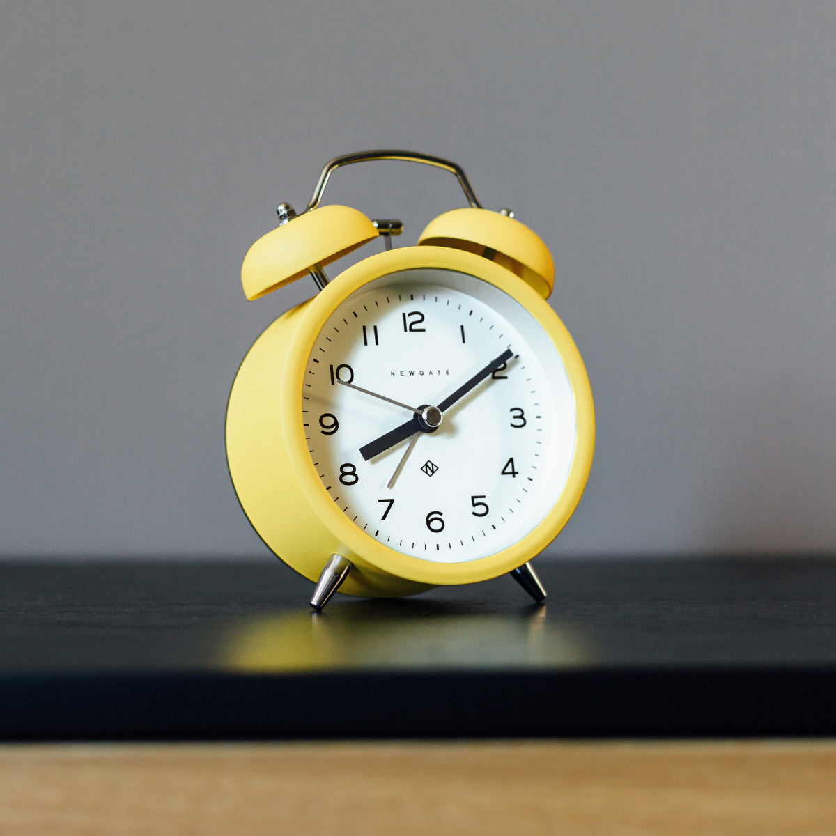 Charlie Bell Echo Alarm Clock In Cheeky Yellow Design By Newgate