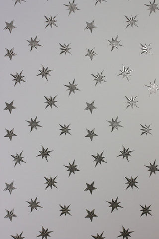 Sirius Wallpaper in silver from the Belvoir Collection by Matthew Williamson