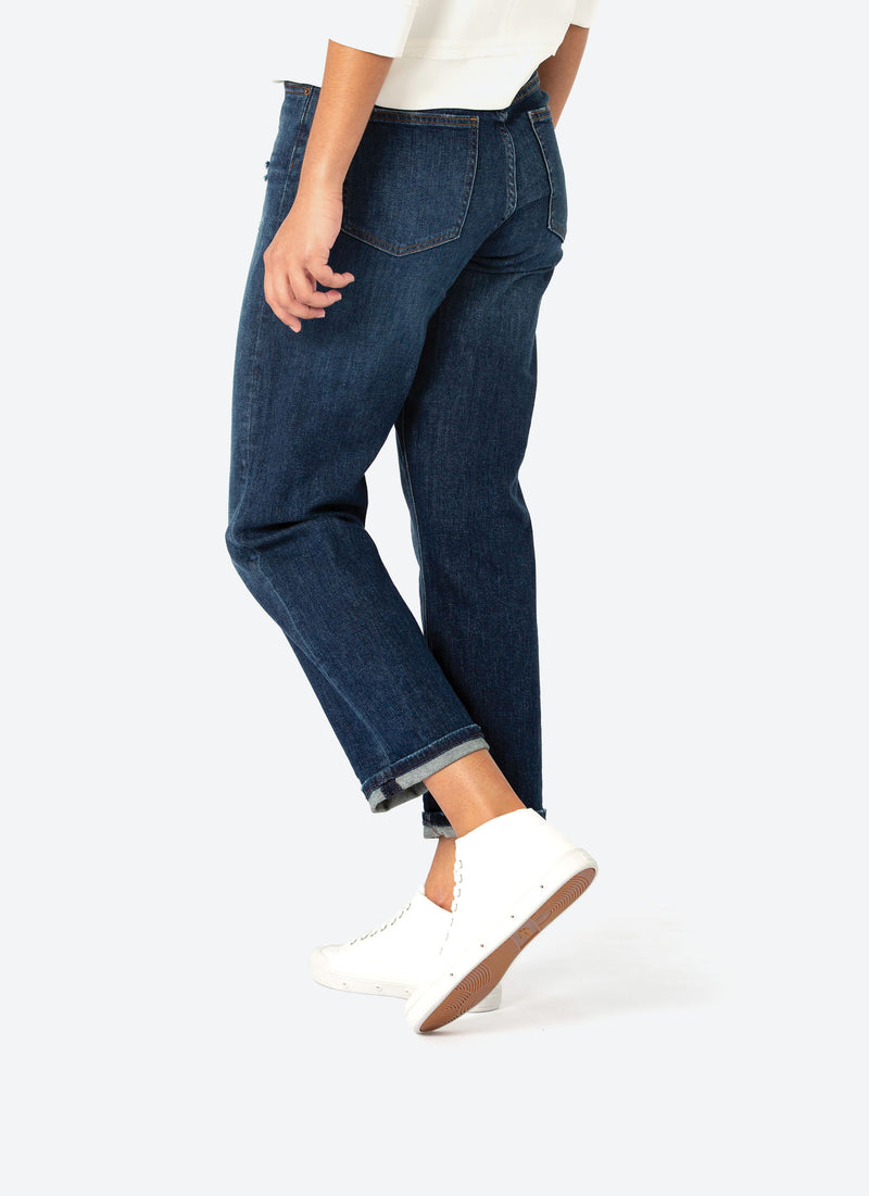 Paired with Crop Demin Jeans women wearing mid cut white sneakers