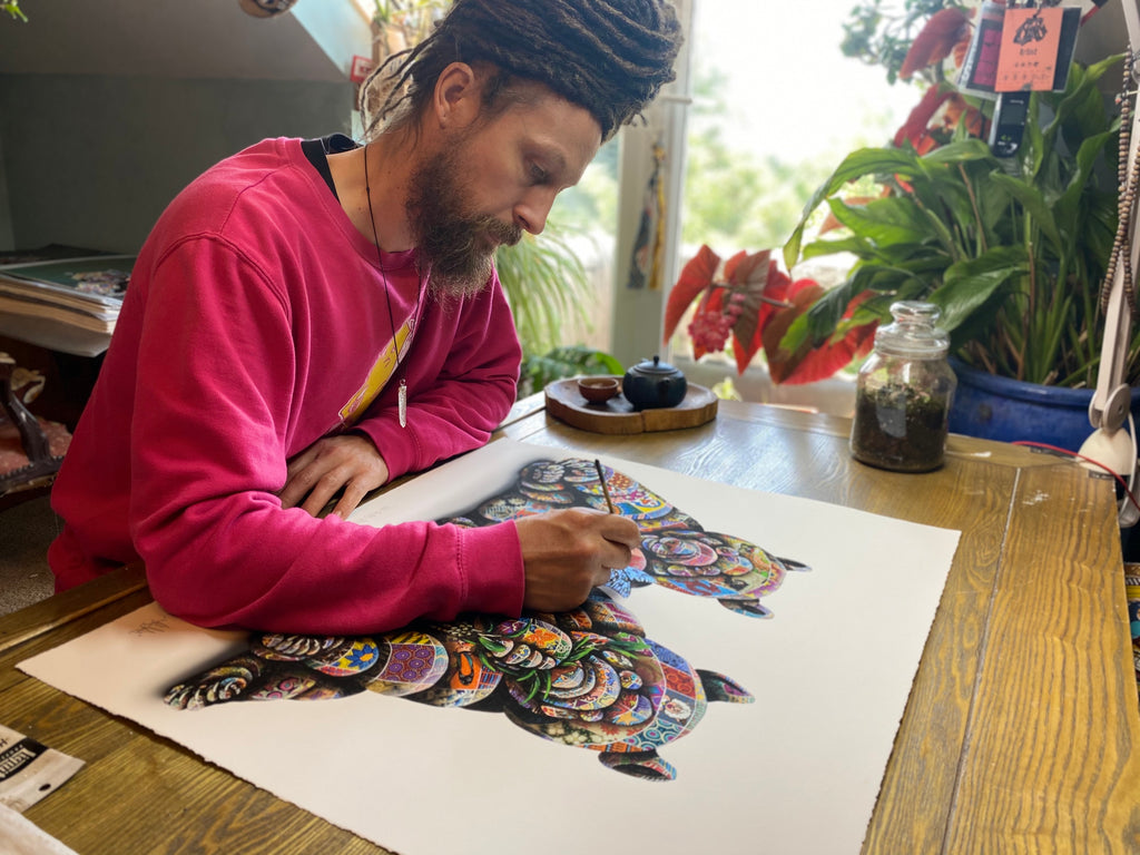 Louis Masai signing Blue Tinted Perspectives art print for Spoke Art Gallery