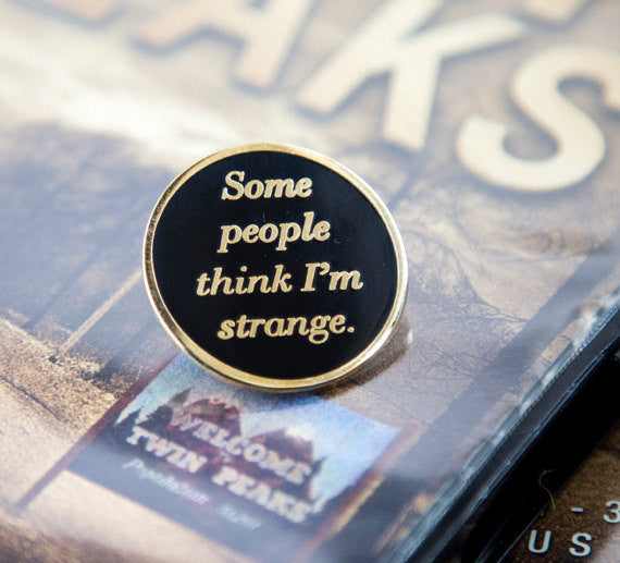 """Some People Think I'm Strange"" Enamel Pin"