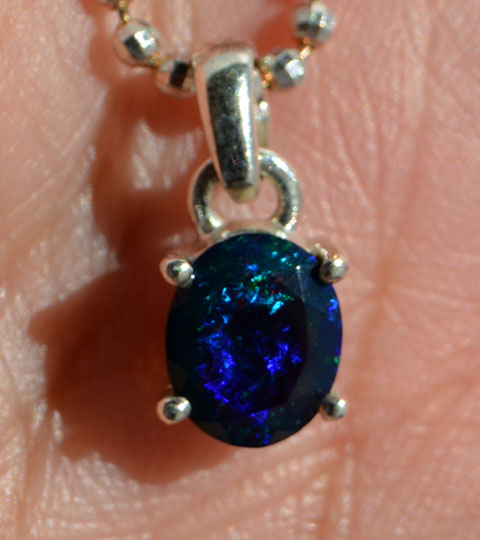 Black precious opal from Australia. Displays a great variety of colours and it has a great depth.