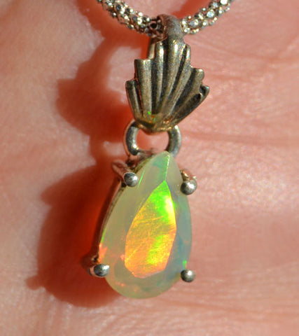 Precious opal with an amazing play of colour ranging from yellows to purples. Super clear gemstone. Pear shape