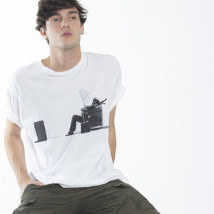 A guy wearing the maxell blown away guy graphic t-shirt from altru apparel