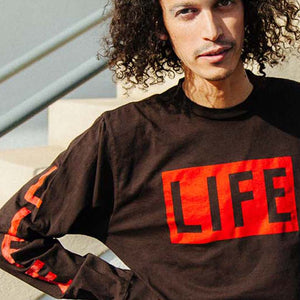 A guy in a long sleeve life logo graphic tee by altru apparel