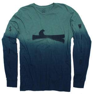 full photo of a dip dye tye die style long sleeve graphic tee of a bear floating in a canoe with the text stay wild on the sleeves