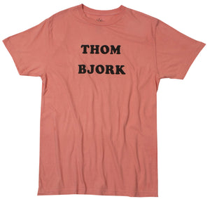 THOM BJORK screen print on front of a pink red enzyme washed tee