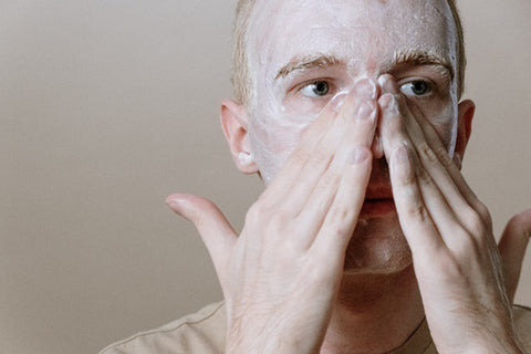 man cleaning his face