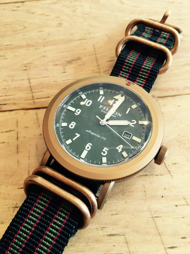 "Bronze Zulu strap 5-ring Black, Red and Green ""James Bond"""