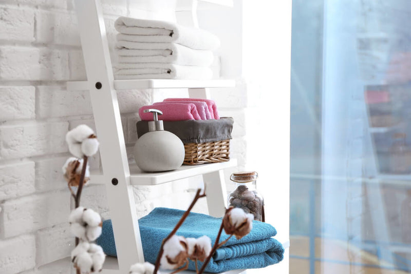 towel types, towels, towel sizes, folded towels on the shelf in the bathroom