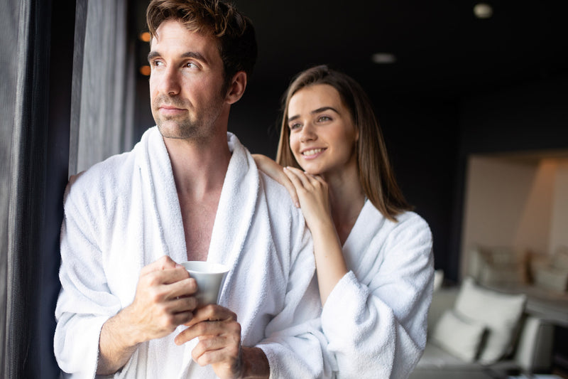 smiling happy couple in bathrobes, what is wellness