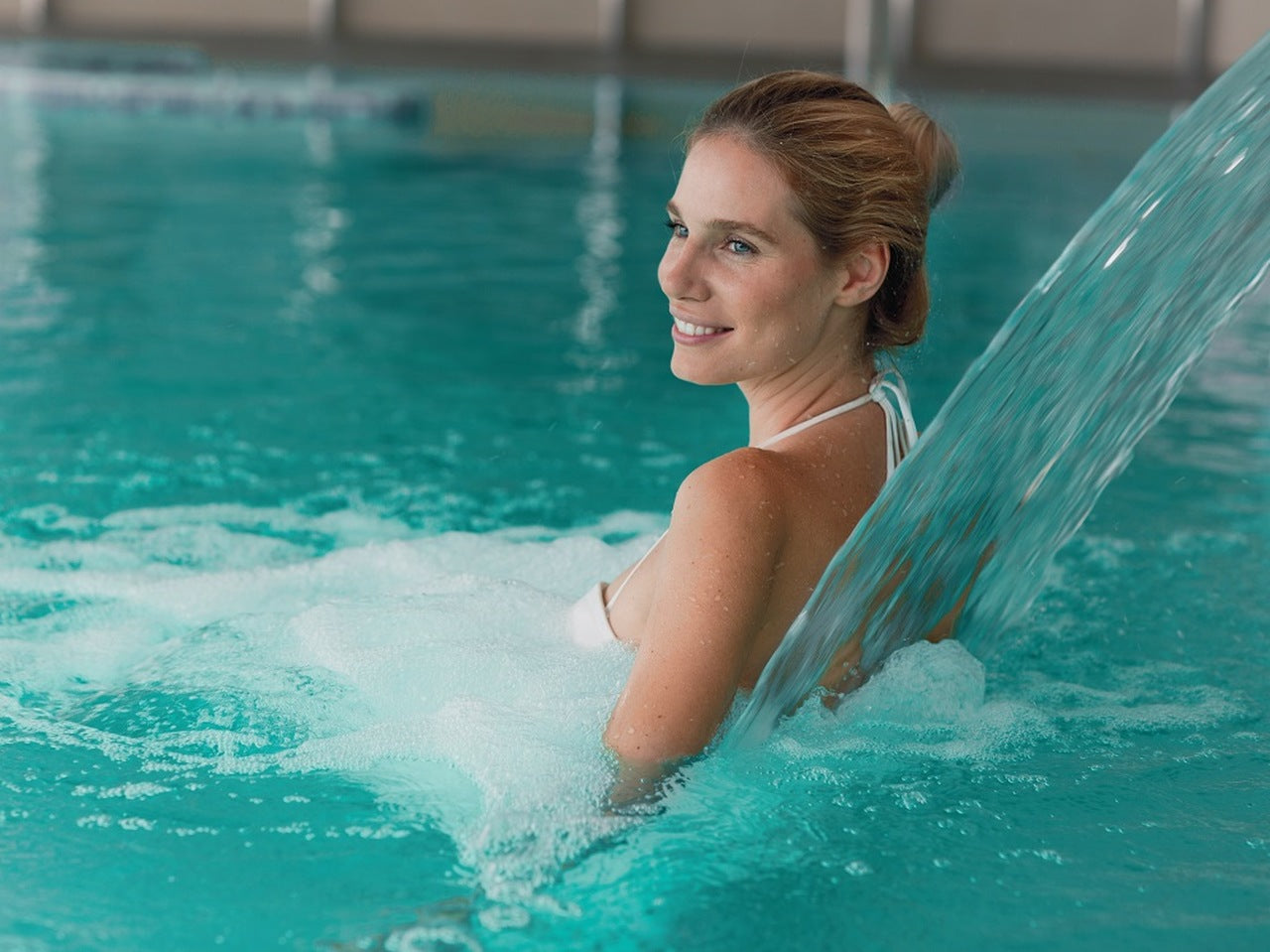 a woman relaxing in a hydrotherapy pool
