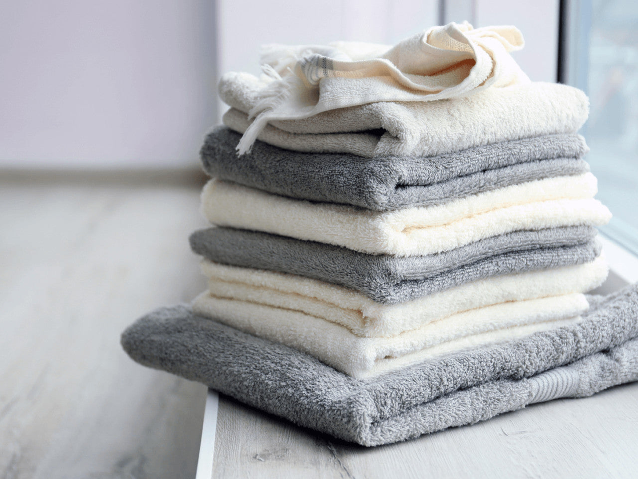 towel types, grey and white towels on the counter.