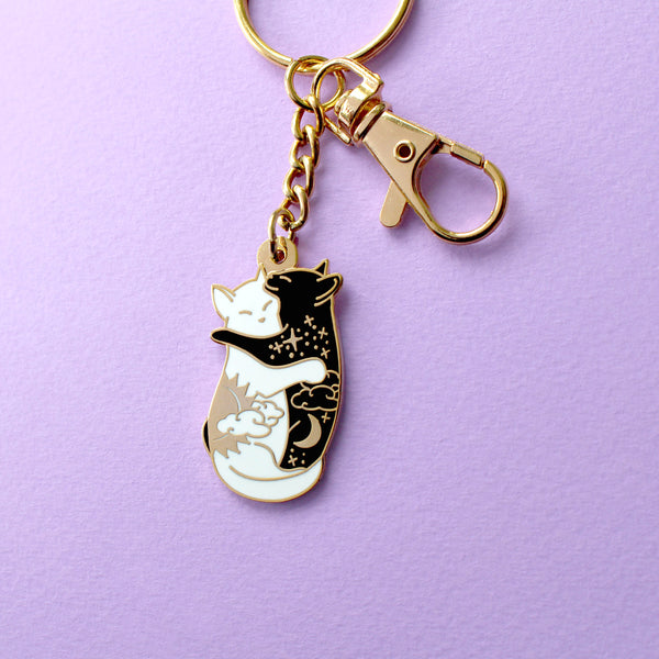 Day & night hugging cats keychain
