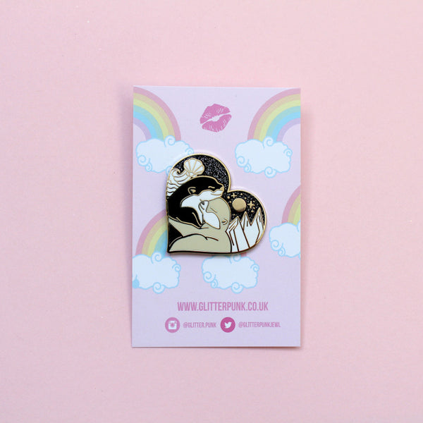 Land & sea hugging otters pin