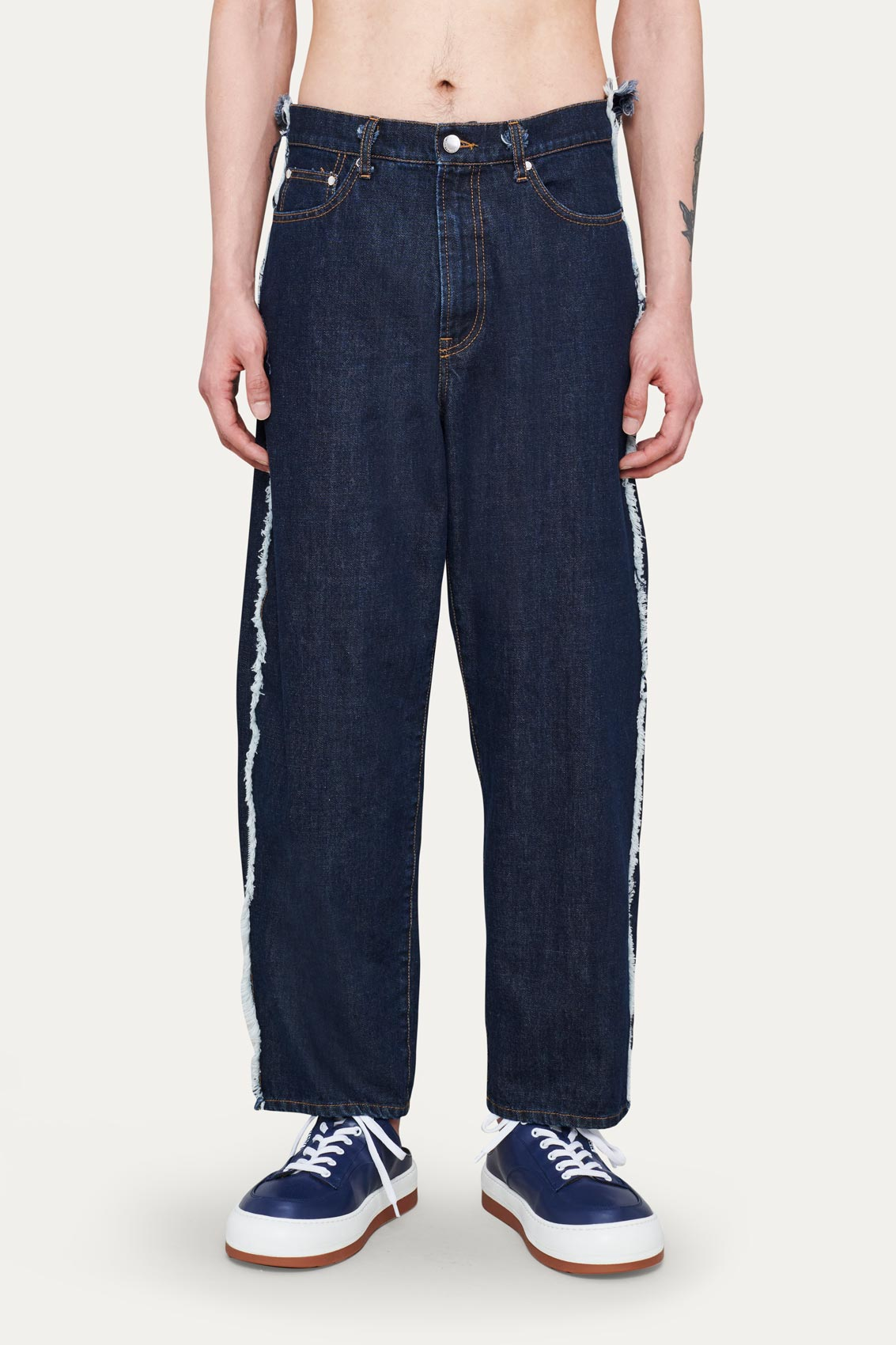 WASHED DENIM CLASSIC PANTS WITH FRINGED BANDS