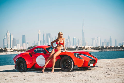 Jannarelly red sports car @sasha.ray dubai blogger