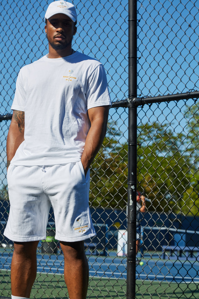 Outside the tennis court where many tennis fans play. Play tennis for fun in our Love Forty, a tennis-inspired capsule collection