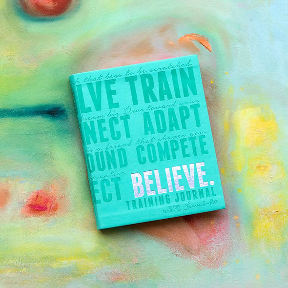 Believe Training Journal Teal. Backdrop painting by Sally Mina.