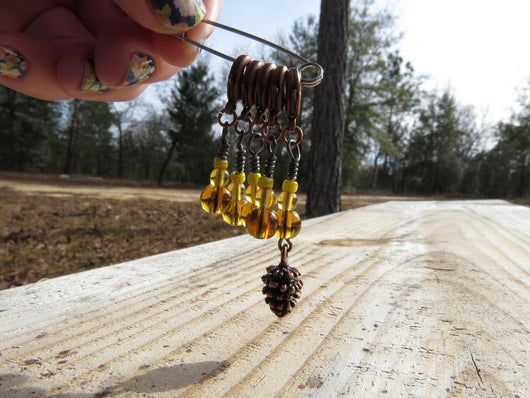 Pine cone stitch marker set in yellow