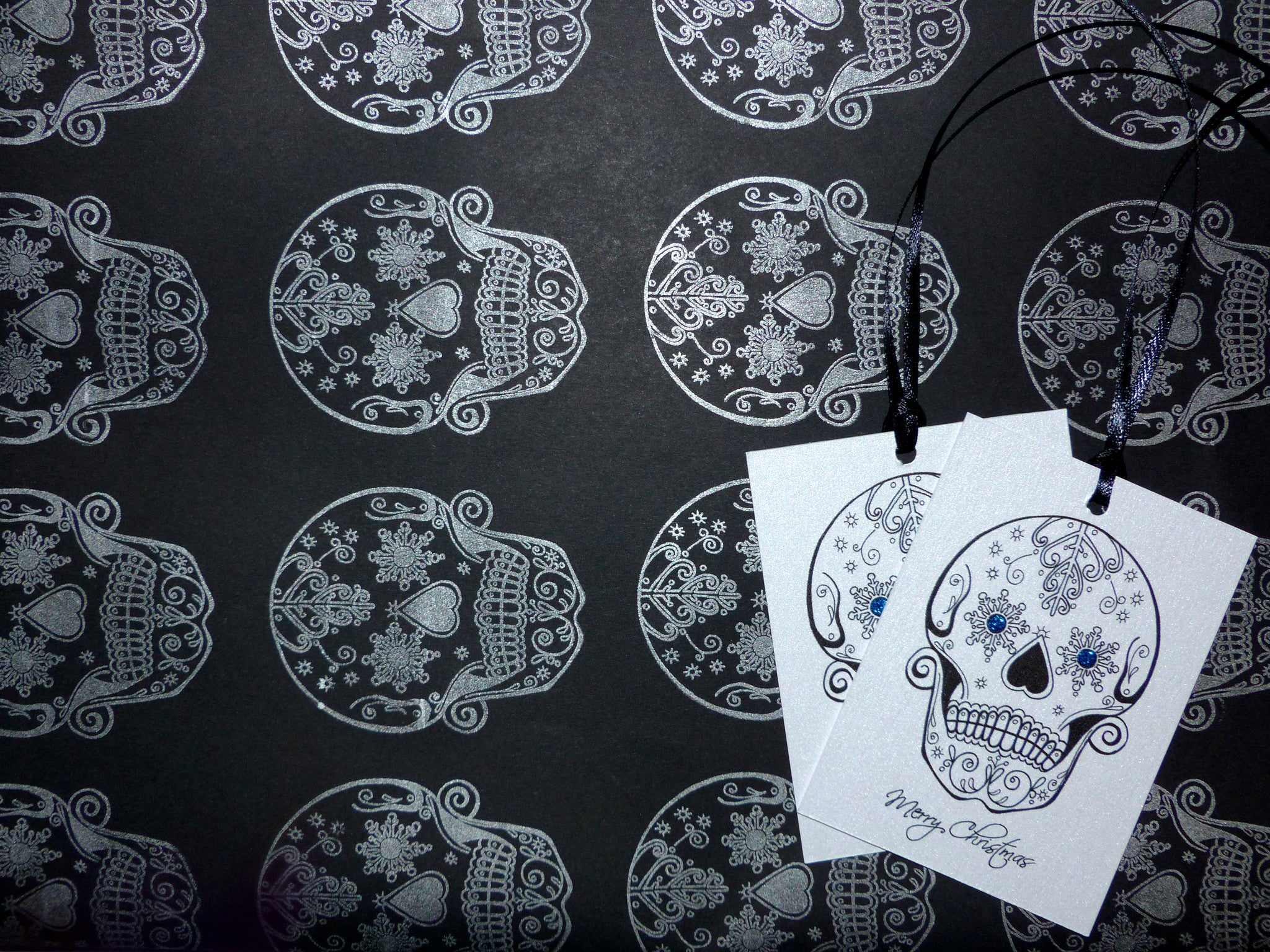 hand stamped christmas wrapping snowflake sugar skull